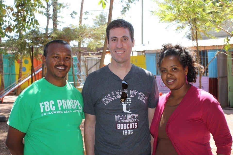 Pastor Mekebib Desta, Brian Carroll and Rahel Tamirat.