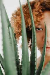 woman behind aloe vera photography