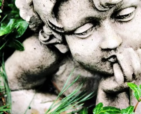 Cherub Statue In Grass