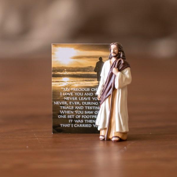 Jesus Figurine with footprints