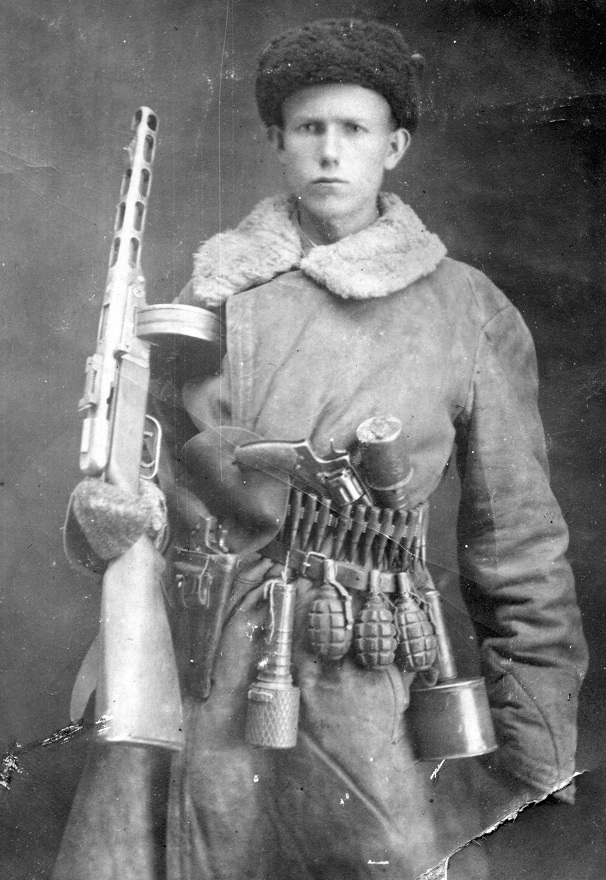 Russian soldier armed to the teeth (PPSh-41, 1895 Nagant, hand grenades)