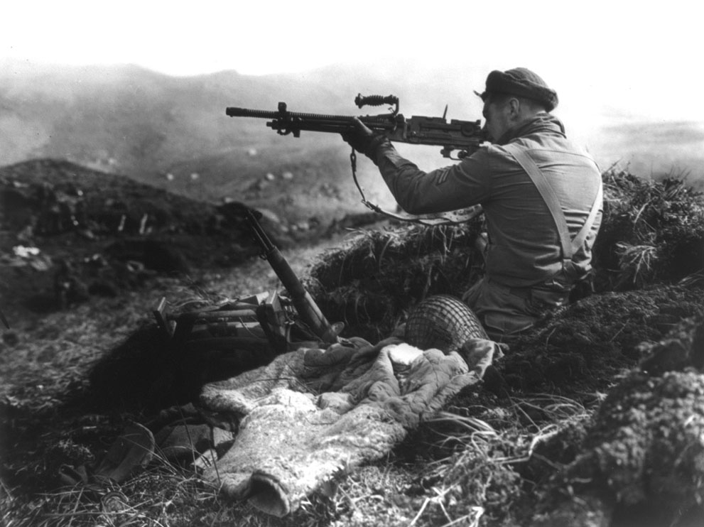 Canadian soldier inspecting a Japanese Type 96 on Kiska, 1944