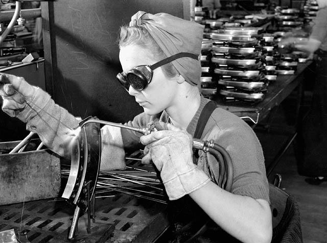 Worker welding a Bren magazine at Inglis