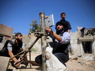 Syrian rebel using an iPad to measure mortar angle