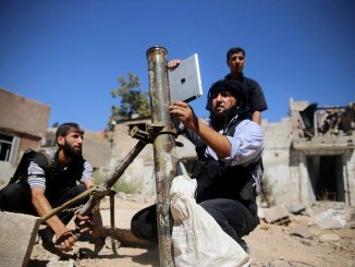 Syrian rebel using an iPad to measure mortar angle