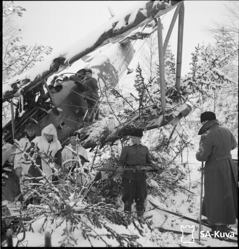 Finnish troops salvaging machine guns from a downed Russian Polikarpov R5 bomber shot down near Suistamo.