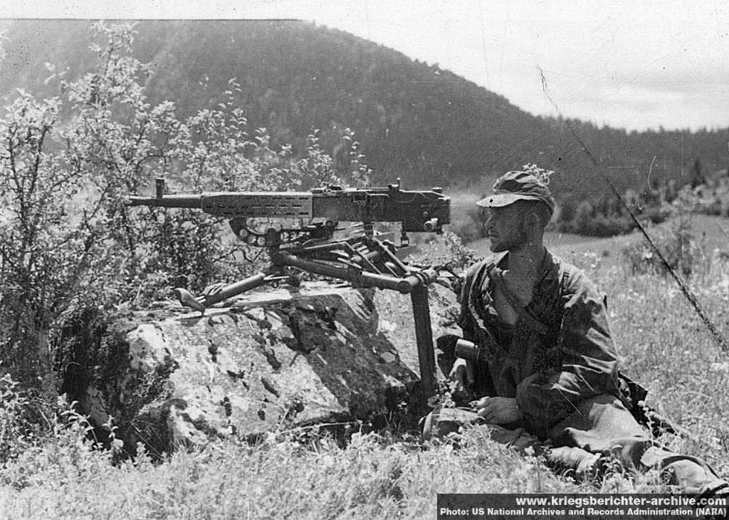 Waffen-SS soldier manning a Czech ZB-37 machine gun on its tripod