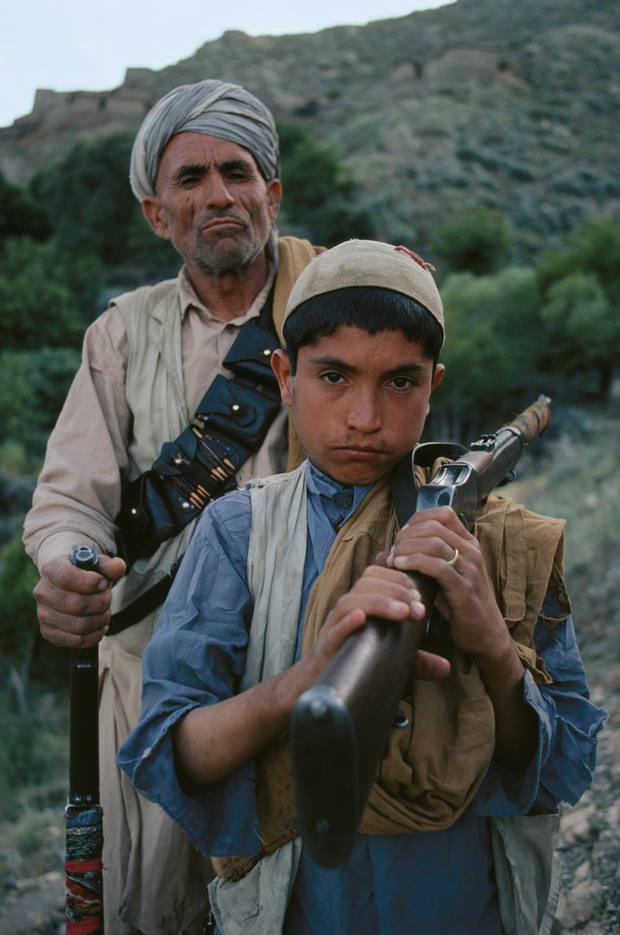 Father (grandfather?) and son in Afghanistan with a Martini and an SMLE.
