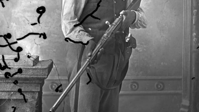 Dakota tribal policeman with a Remington-Keene rifle
