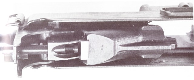 Horn rifle piston in the unlocked position