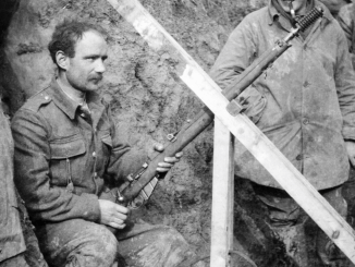 2nd Lieutenant L. J. Barley of the 1st Battalion, Cameronians (Scottish Rifles), watching as a rifle grenade is prepared for firing from trenches at Grande Flamengrie Farm on the Bois Grenier sector of the line during February 1915.