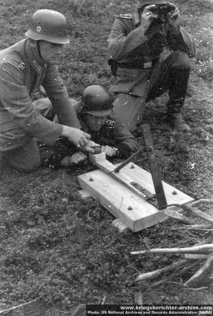 German soldiers experimenting with a grenade catapult