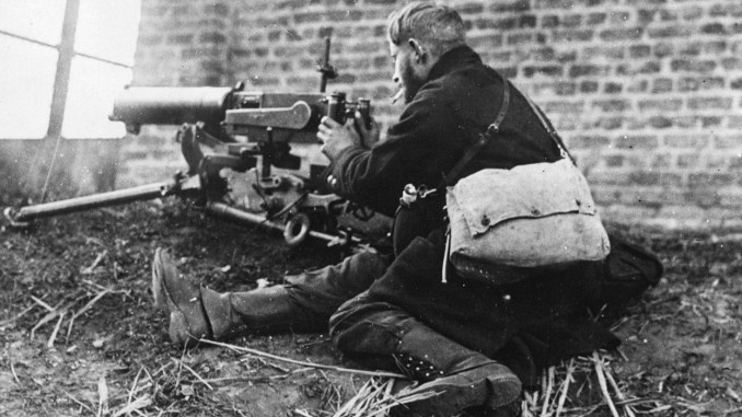 Belgian soldier smokes a cigarette during a fight between Dendermonde and Oudegem Belgium in 1914.