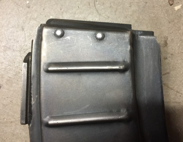 Top of XM19 magazine - note two rivets which attach to the magazine springs