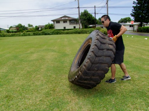 Pushing a tractor tire