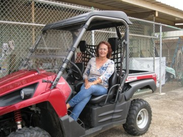 Office Manager, SANDY SANCHEZ ON A 2012 KAWASAKI TERYX 750