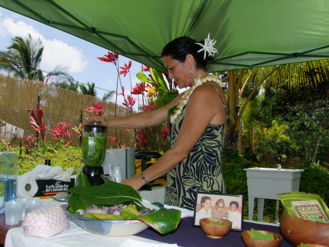 Blending a green smoothie of healing plants