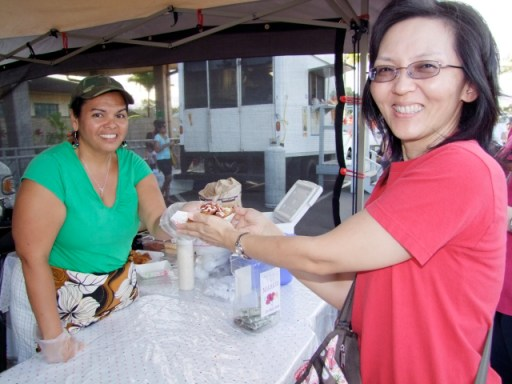 Rhonda Cabello hands Midori Komar her dish from JC's Puerto Rican Kitchen, aka Cabello's.