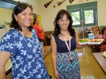 Debbie Lindsey (l) and Leila Kobayashi, student services coordinator and acting assistant principal at Koloa Elementary School