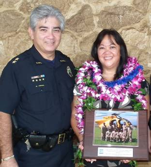 Assistant Chief Roy Asher with Tech Sgt. Johnette Chun. Courtesy photo