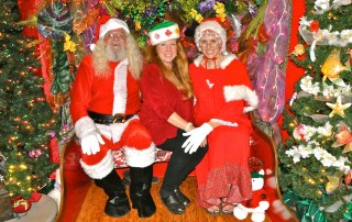 The Clauses and the Festival of Lights lady, 2011. L-R: Michael Patton as Santa; Elizabeth Freeman, festival head; and Jewels Tidwell as Mrs. Claus. Photo by Danny Hashimoto