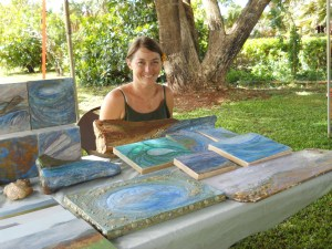 Caylin Spear displays her  encaustics on wood. They are original seascape paintings made with wax. Photo courtesy Women Artists of Kauai.