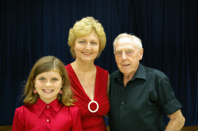 Youngest and oldest Kaua`i Chorale members with director