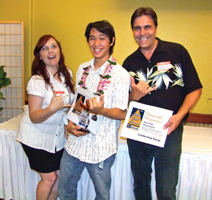 Leadership Kaua`i had a couple of awards within awards. John Medeiros, center is a graduate of the Leadership Kaua`i Youth program and won the Aloha Spirit Award for Youth Leadership. Leadership Kaua`i received Honorable Mention in the Nonprofit Organization category and Jerry Brocklehurst (r) executive director of KL, accepted that award along with Lana Spencer (r). Photo by Anne E. O'Malley