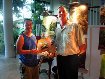 On left, artist Glenn T. Ichimura shares a beautiful piece of his work with the new Resort Manager of the Kauai Beach Resort, Mark Burson.  Mark has returned to Kaua`i after a few years of working off island and is so happy to join the Management team at the Kauai Beach Resort.