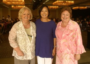 From left to right, Music Scholarship Chair Barbara Adair, Mokihana Club President Winnie Lu and Fashion Show Chair Helena Coonley.