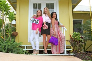 Maikalani Kahana is seen holding an OPEN sign in front of her Mint and Sea store, which she opened last year in Wailua. Wedding coordinator Heather Singleton is in the center, and fashion designer Kapua Kaneakua holds one the unique bags she creates with vintage shirts.