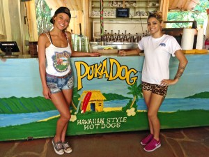 "Puka Dog in Po'ipu and recently also in Hanalei, make their own sauces. Their puka buns are made on Kaua'i, using a special oven invented by the grandfather of Jenna Muschara, left. She and Sanoe Mainaaupo, right, also offer a vegetarian, non-GMO hot-dog and freshly squeezed lemonade, ""shaken, not stirred,"" Jenna said."