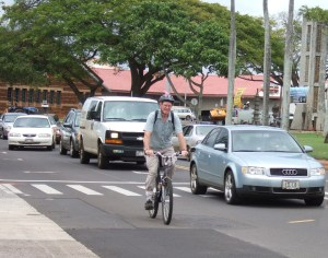 When cycling with confidence, motorists and bicyclists coexist peacefully even on congested Rice Street.