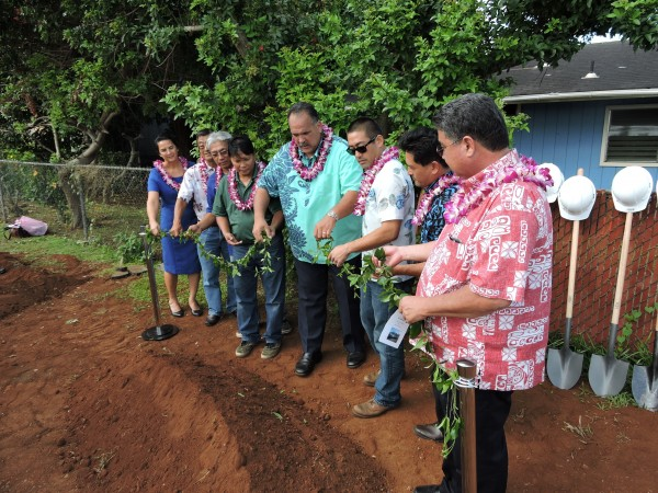 Local dignitaries untie the maile lei in a ceremony today marking the start of Kaua'i County's Island-wide Bus Shelter Project. From L: Transportation Director Celia Mahikoa; Larry Masutani, executive director, Site Engineering; Jimmy Iloreta and Benson Peralta, Kaua'i Filipino Community Council; Mayor Bernard Carvalho, Jr.; state Rep. Derek Kawakami; Kauai County Council Vice Chair Mason Chock; and state Sen. Ronald Kouchi.