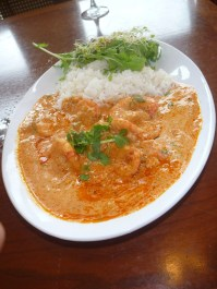 The Shrimp Muqueca, shown here, was delicious. We also had the Fresh Catch Muqueca, the most popular dish on the menu, with fish simmered in a rich coconut and tomato sauce, served with white rice and beans.