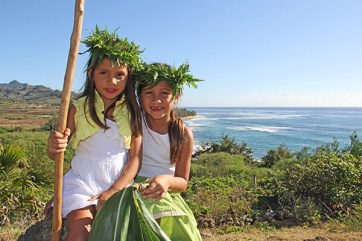 Sisters Hi'iaka and 'Anonui Emery, with Maha'ulepu Beach on the background.