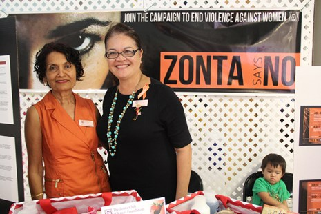 Zonta Club's Savita Kumar, left, and Darrelyn Lemke, with little Makoa Lemke.