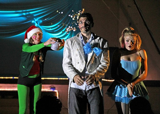 A mischievous elf, played by Meghan Ornellas-Goodale, throws some magic dust over Yacine Merzouk and Corissa Berrett, freezing them during The Snow Queen children's play at All Saints Gym in Kapa'a Dec. 12.