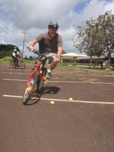 Kenny Ishii (foreground) and Angelo Catiggay practice weaving through an obstacle course in the Bicycling Skills for Adults free class. Kaua'i Path will be teaching Bicycling Skills for Adults with support from the Hawai'i State Department of Transportation. Photo by Tommy Noyes