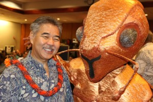 Gov. David Ige and a little fire ant Monday at the state Capitol.