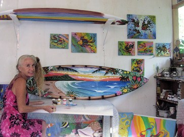 Zoe Babit painting a surfboard.