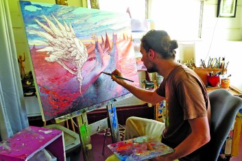 Max Lemaire painting in his studio.