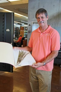 NTBG CEO and Director Chipper Wichman shows a plant specimen at the Research Center.