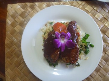 Hawaiian Style Pork Ribs served with oven-fried rice with steamed greens. These ribs are full of sweet tropical flavor, boneless and tender enough to eat with a fork.