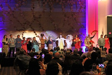 Kristian Lei sings while several Filipino celebrities take the stage.