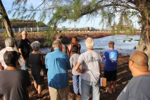 Marine biologist and Malama Hule'ia board director Carl Berg shows the public what volunteers have accomplished at the demonstration site in Nawiliwili.