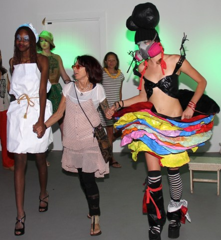 Artist Sally French, center, and two models wearing French's creations.