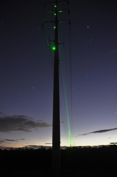 Kaua'i Island Utility Cooperative is again experimenting with lasers and other devices to reduce collisions between endangered seabirds and utility equipment during the season when the seabird colonies are most active. Photo credit: Shelley Paik, Kaua'i Island Utility Cooperative