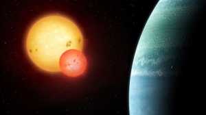Artist's impression of the Kepler-453 system showing the newly discovered planet on the right and the eclipsing binary stars on the left. Illustration by Mark Garlick.
