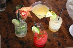 Kaua'i Grill signature cocktails, clockwise from center: Tahitian Pineapple, Ginger Margarita, Moloa'a Mule, and Garden Smash.